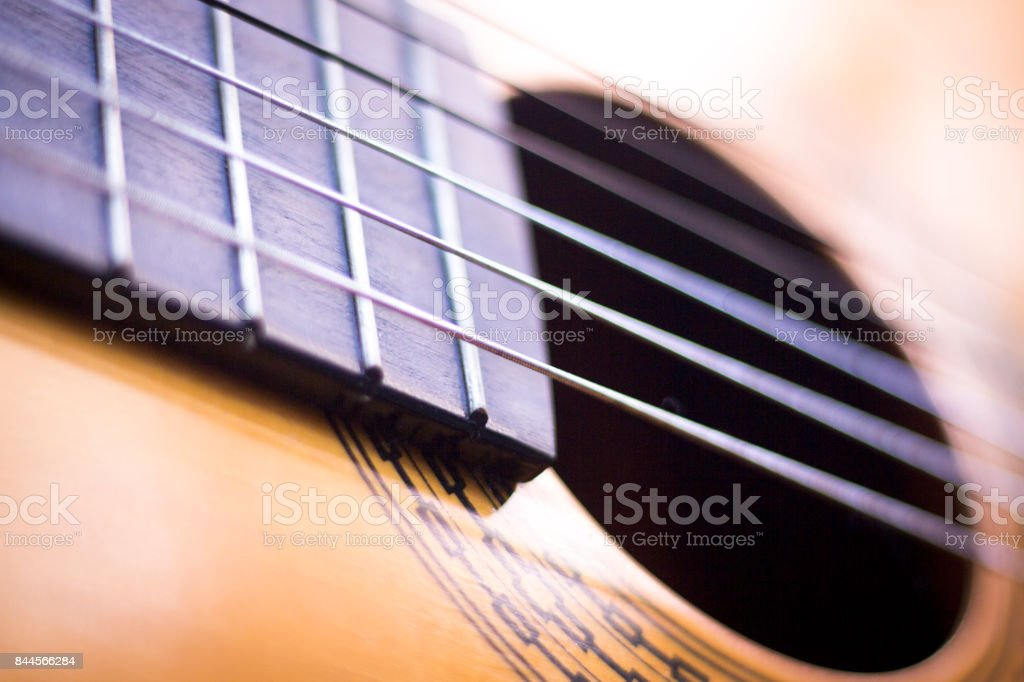 Spanish traditional flamenco wooden acoustic guitar strings and fretboard. stock photo