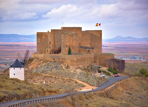 Spanish windmills and castle at a cloudy day stock photo