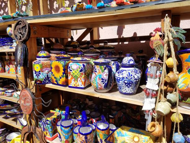 spanish/mexican style of pottery/ceramics on a display shelf - souvenir foto e immagini stock