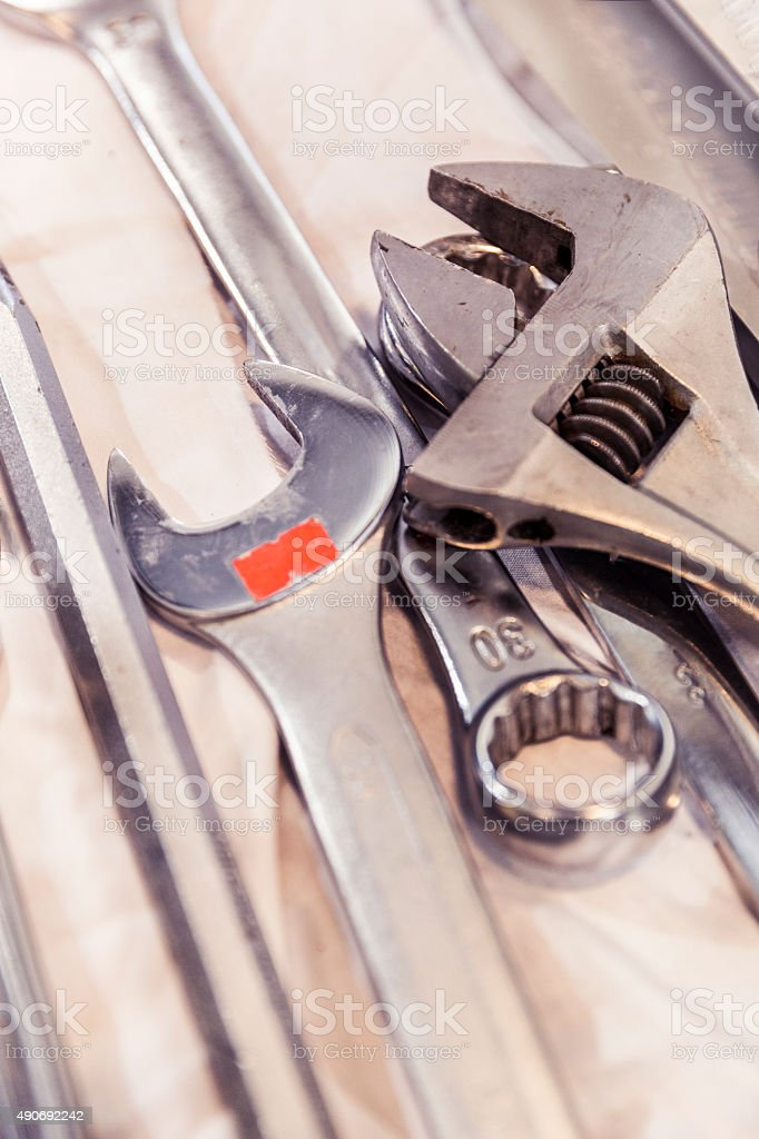 Spanner and wrenches on table at factory stock photo