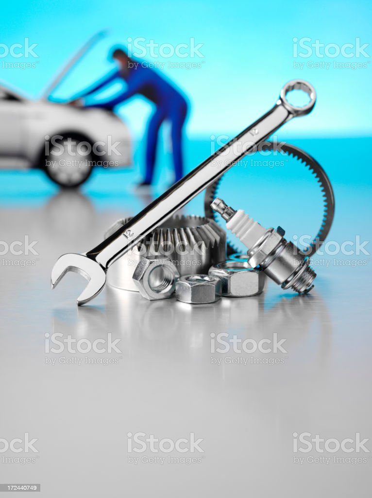 Spanner with Spark Plug and Car Mechanic royalty-free stock photo