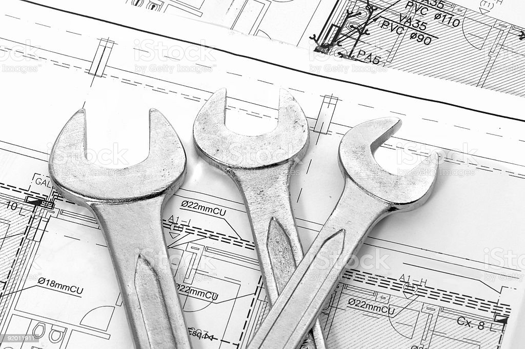 Spanners and house plan royalty-free stock photo