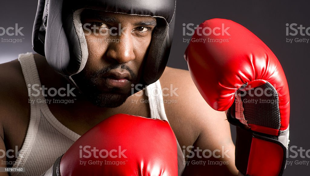 Spar Ready Tough Guy Covers in Head Gear and Gloves royalty-free stock photo
