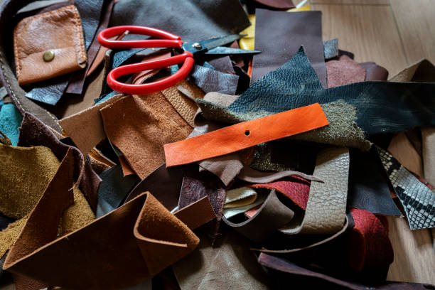 spare and waste leather materials on studio floor