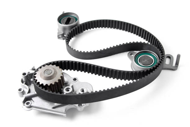Spare parts for the ca r. Kit of timing belt with rollers on a light background. stock photo