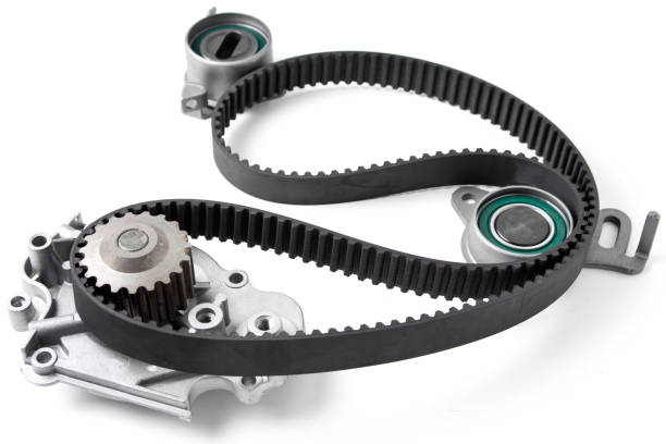 spare parts for the car. kit of timing belt with rollers on a light background. - belt stock photos and pictures