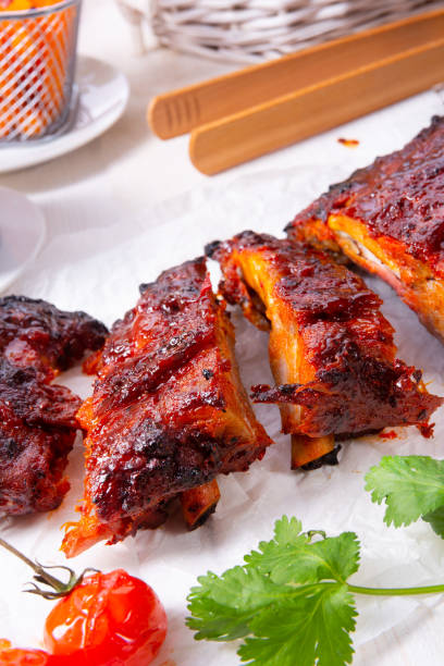 BBQ spare ribs from a charcoal grill – zdjęcie