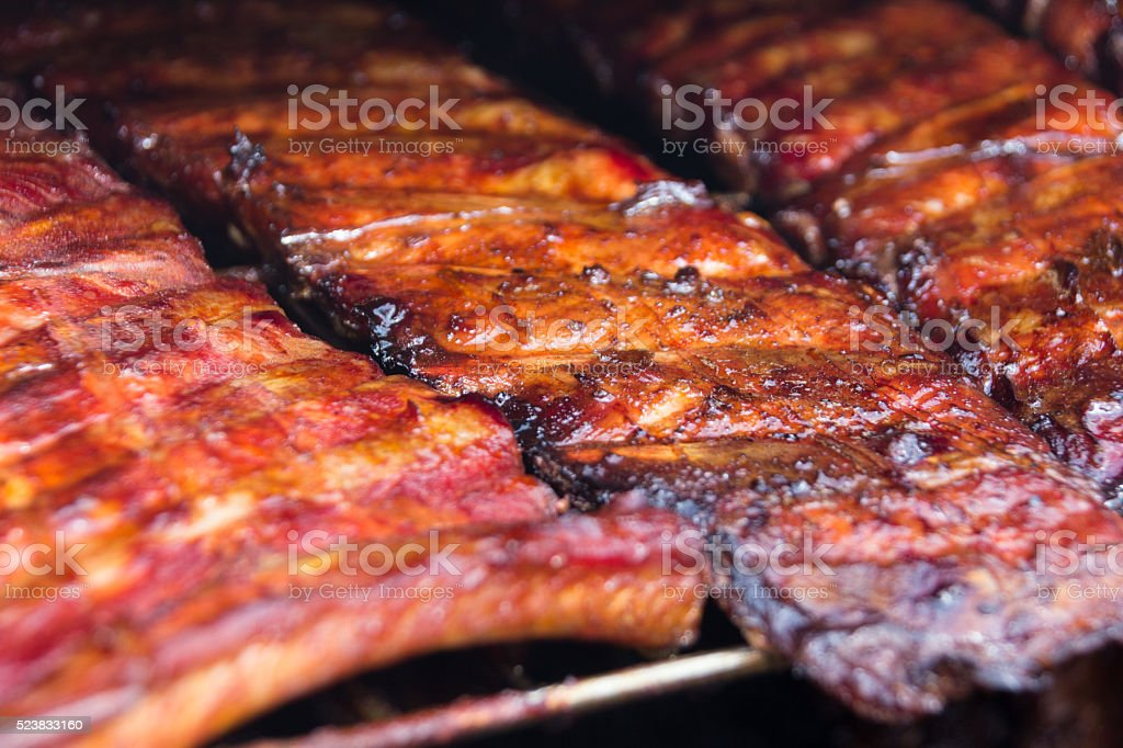 Spare ribs on grill - smoked pork ribs stock photo