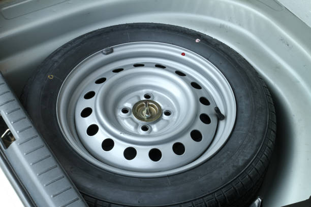 Spare wheel in storage bin stock photo