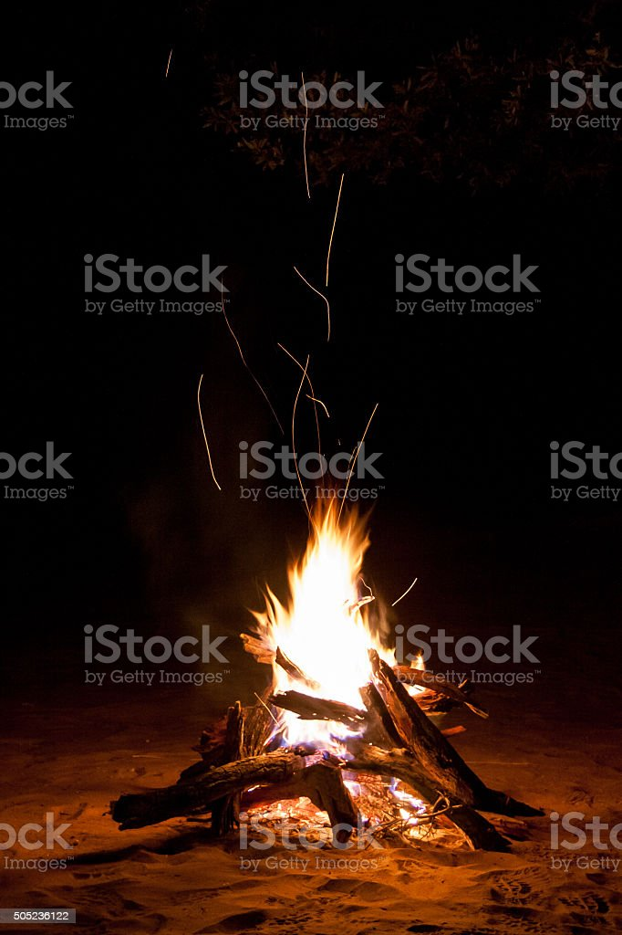 Sparking Camp Fire in the Night stock photo