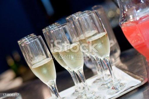 A tray of champagne in flutes at a reception.