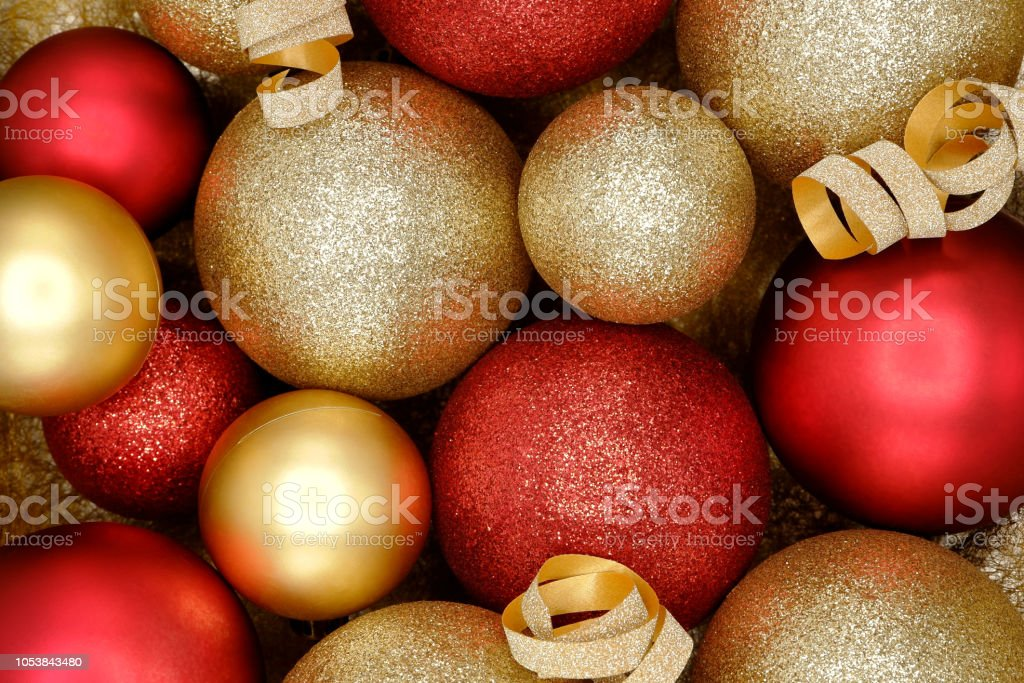 sparkle red and gold christmas ornaments background picture id1053843480
