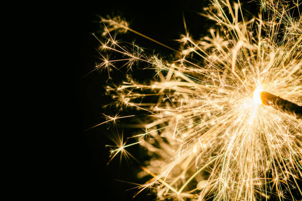 Sparkler as background on the theme of New Year's Eve backgrounds pyrotechnic effects stock pictures, royalty-free photos & images