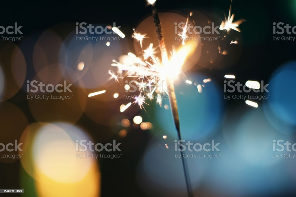 Sparkler  Bokeh  Colorful sparkler. Night background with a sparkler. stock photo