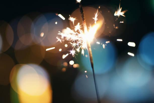 Sparkler  Bokeh  Colorful sparkler. Night background with a sparkler. stock photo