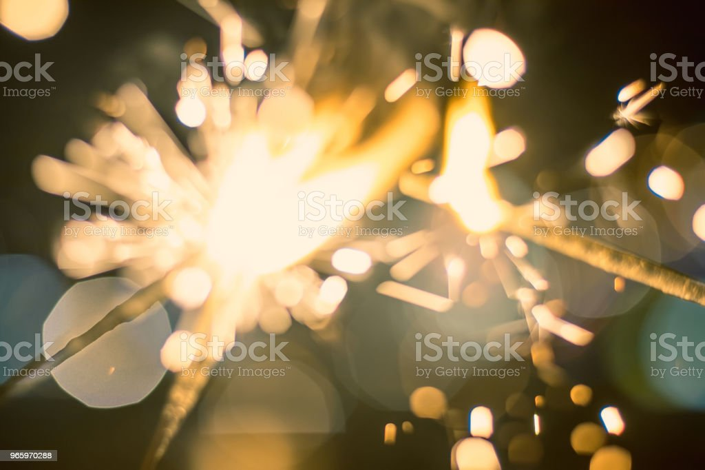Sparkler Bokeh Colorful sparkler. Night background with a sparkler. - Royalty-free Activity Stock Photo