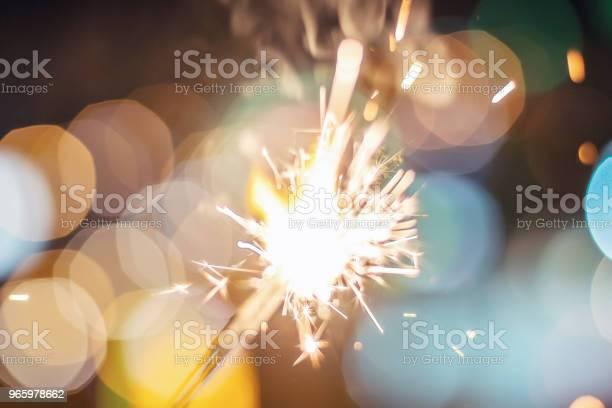 Sparkler Bokeh Colorful Sparkler Night Background With A Sparkler - Fotografias de stock e mais imagens de Aniversário especial