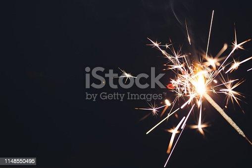 Sparkler fireworks on black background. Special occasion, celebration, birthday, Christmas concepts.