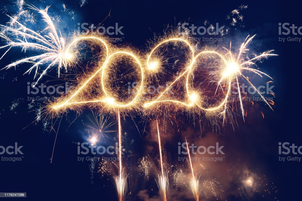 Sparkler Happy New Year 2020 With Fireworks Sparkler Happy New Year 2020 With Fireworks 2020 Stock Photo