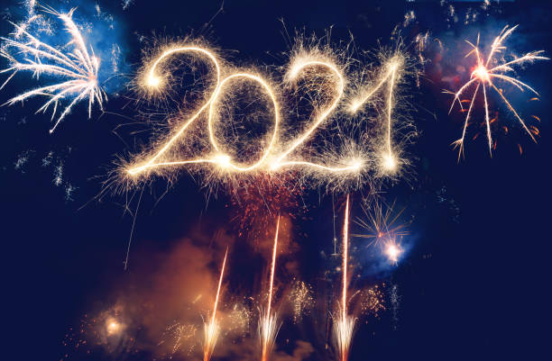 Sparkler Happy New Year 2021 With Fireworks Sparkler Happy New Year 2021 With Fireworks happy new year 2021 stock pictures, royalty-free photos & images
