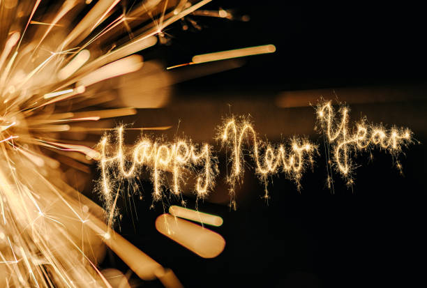 sparkler happy new year - new years day stock pictures, royalty-free photos & images