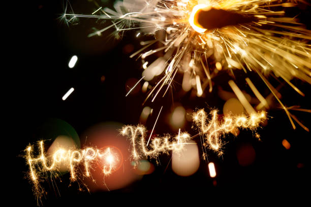 Sparkler Happy New Year With Fireworks stock photo
