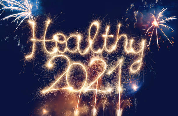 Sparkler Healthy 2021 With Fireworks stock photo