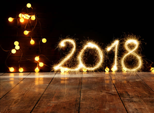Sparkler New Year 2018 On Wooden Floor stock photo
