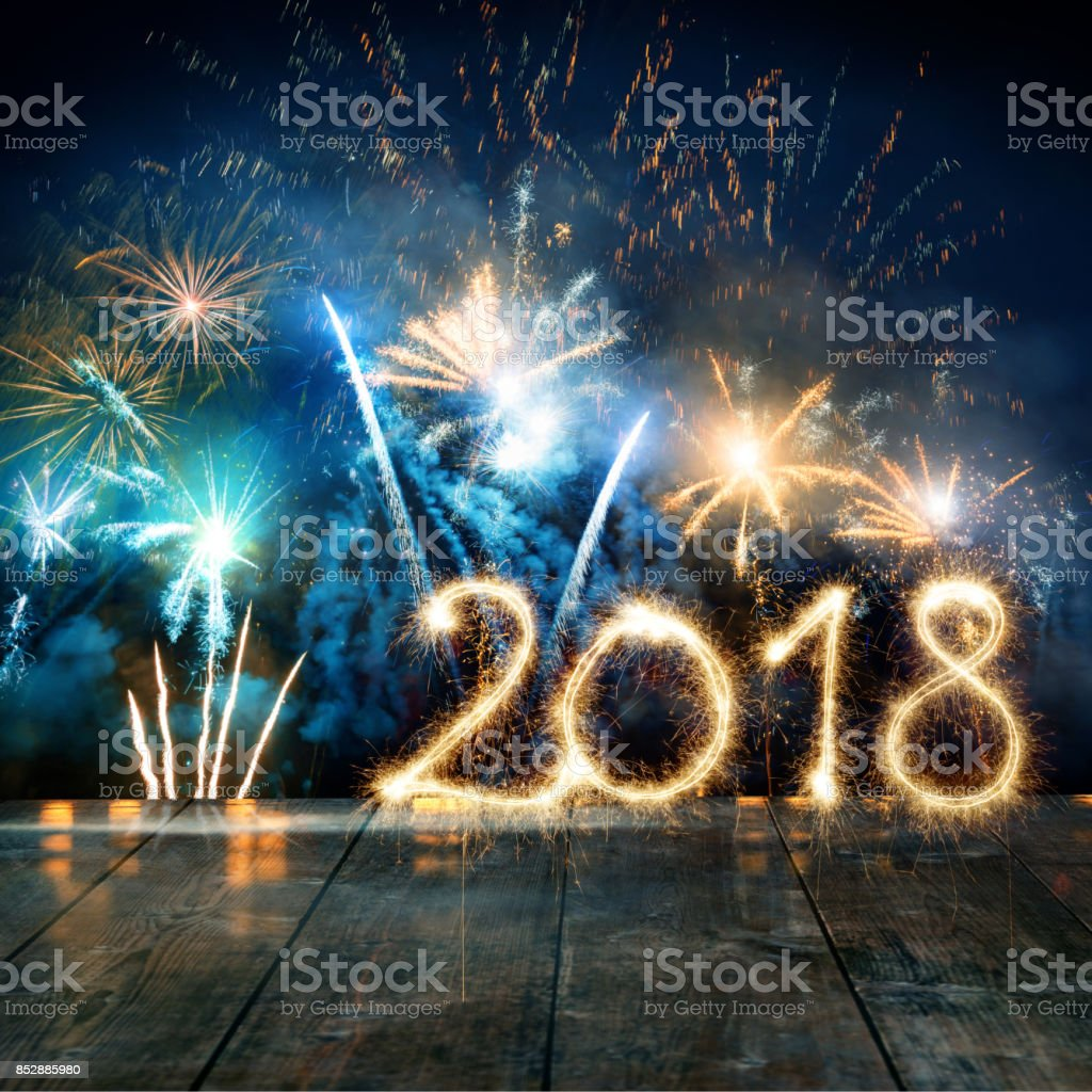 Sparkler New Year 2018 With Fireworks On Wooden Floor stock photo