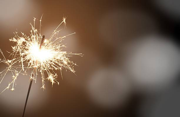 sparkler - new year's eve - anniversary stock photos and pictures