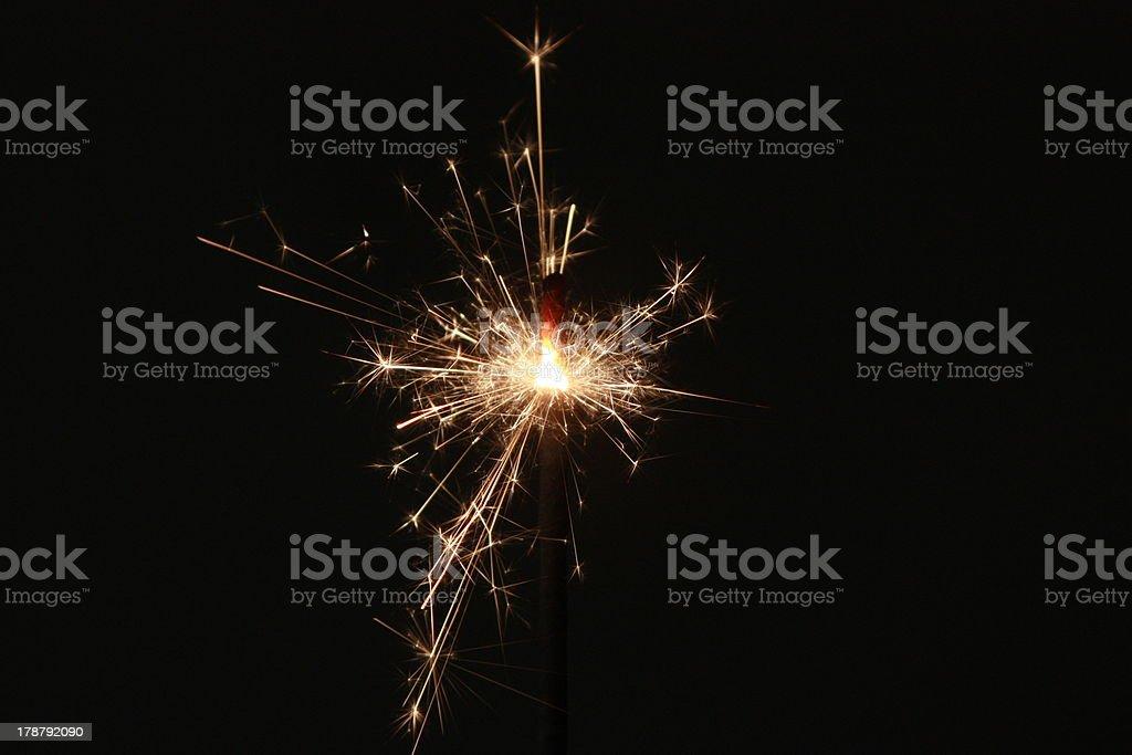 Sparkler on a dark background stock photo