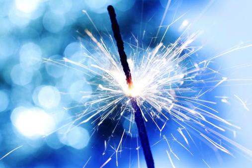 sparkler on blue bokeh background macro close up