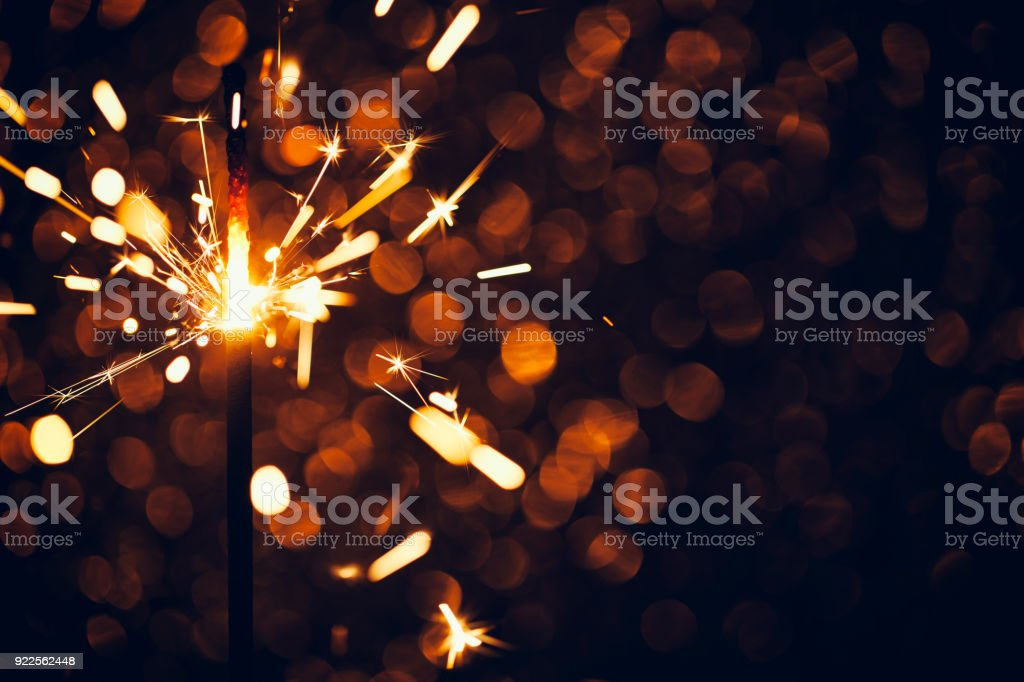 Sparkler on defocused Background stock photo