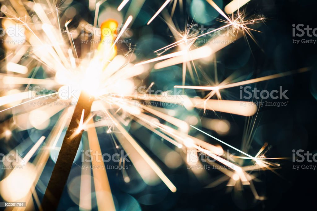 Sparkler on defocused Blue Background stock photo