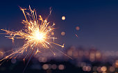 Sparkler with blurred city light background, Happy New Year