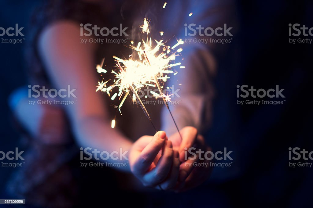 sparklers in the hands of the couple royalty-free stock photo