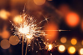 Sparklers on Christmas lights background