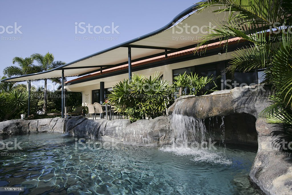 Sparkling Blue Pool In Posh Home royalty-free stock photo