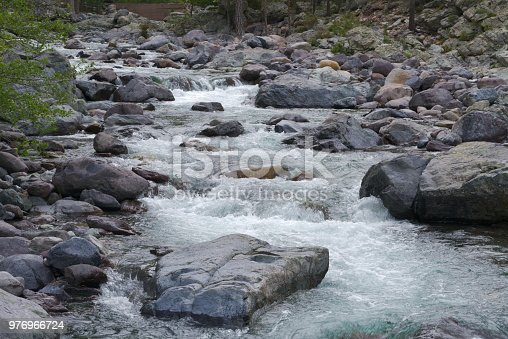 Sparkling water between stones of a river