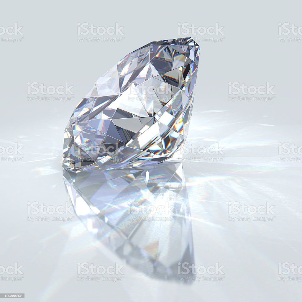 Sparkling, clear diamond glistening in the light on its side stock photo