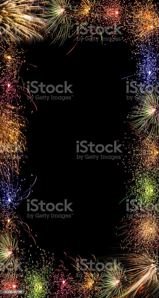 sparkling colorful fireworks frame border vertical black background royalty free stock photo