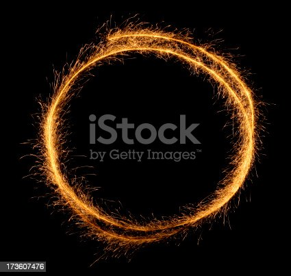 Round frame made of sparkler trace. You can add your message inside. Isolated on black.