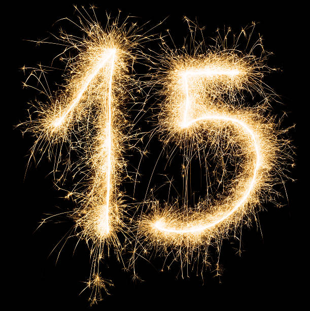 Sparkling golden celebration number fifteen 15th birthday stock photo
