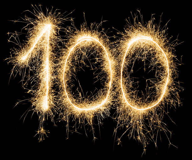 Sparkling golden celebration number one hundred 100th birthday Birthday number 100 in gold sparklers on black background. 100th anniversary stock pictures, royalty-free photos & images