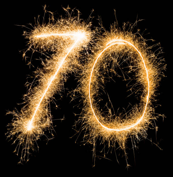 Sparkling golden celebration number seventy 70th birthday stock photo