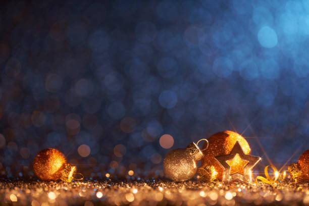 Sparkling Golden Christmas Ornaments - Decoration Defocused Bokeh Background stock photo