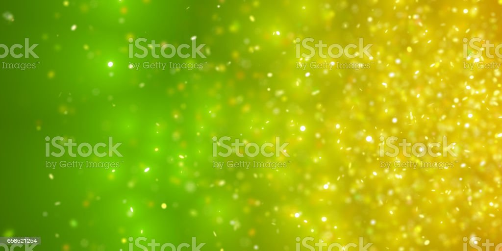 sparkling golden  glitter in front of a green and yellow background stock photo