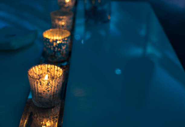 Sparkling Holiday Candles in Blue Ambience Christmas Home Decor stock photo