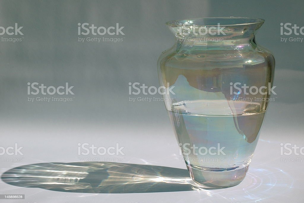 Sparkling Iridescent Glass Vase and Reflection stock photo