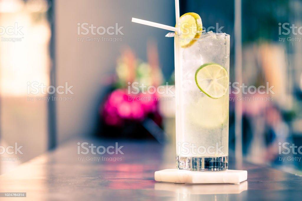 Sparkling lemon soda juice in glass served in restaurant stock photo